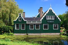 Green Country Side House. Dutch Calm and Quiet Countryside house bordered by green water canal, Zaanse Schans, Netherlands royalty free stock photos