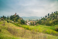 The green countryside around the clock tower Stock Photo
