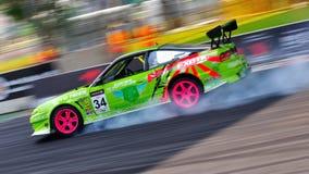 Green Coupe drifting at Formula Drift 2010 royalty free stock photos