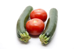 Green courgette and tomato Stock Image