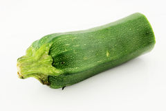 Green Courgette (Zucchini). On white background Royalty Free Stock Photo