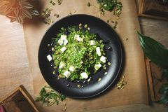 Green couscous and goat cheese salad stock photo