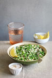Green Couscous salad with peas and fresh mint Stock Photography