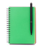 Green cover notebook with black pen Stock Photo