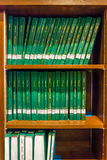 Green cover thesis on the bookselfs on Chulalongkorn university Royalty Free Stock Image