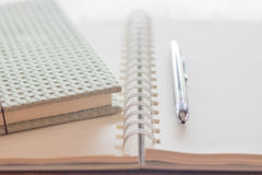 Green covered notebook and pen Stock Photography