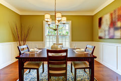Green craftsman large dining room. Royalty Free Stock Photos