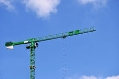 Green crane in the Birmingham city center on the beautiful sky Stock Image