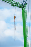Green crane with a chain Stock Photo