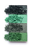 Green crashed eyeshadow for makeup as sample of cosmetic product Stock Image