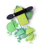 Green crashed eyeshadow for makeup as sample of cosmetics product with applicator. Green crashed eyeshadow for make up as sample of cosmetics product with Royalty Free Stock Photo