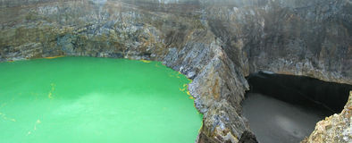 The green crater lake. And the black one - Kelimutu volcano - Flores - Indonesia - Panorama Stock Images