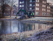 Green crawler dozer working in the toen park royalty free stock images