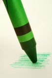 Green Crayon. A green color crayon and paper royalty free stock images