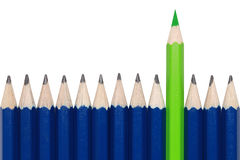 Green crayon standing out from the crowd Stock Images