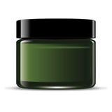 Green cream jar. Green glass face cream jar with black cap Royalty Free Stock Photos