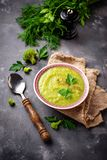 Green cream soup with broccoli Stock Photography