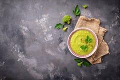 Green cream soup with broccoli Stock Photos