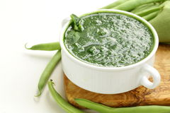 Green cream soup of spinach and green peas Stock Photo