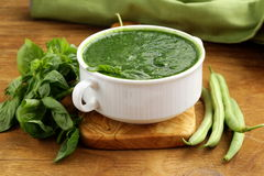 Green cream soup of spinach and green peas Royalty Free Stock Photos