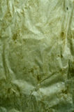 Green creased paper. Green crumpled paper abstract background stock photo