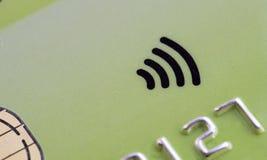 Green Credit card with contactless symbol Stock Photos
