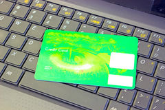New funds for payment. Green credit card on laptop, photography Royalty Free Stock Photo
