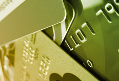 Green Credit Cards. A Closeup of credit cards are green in saturation Royalty Free Stock Image