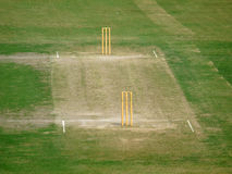 Green Cricket Pitch. Empty Cricket Pitch with Wickets and Bails on Royalty Free Stock Photo