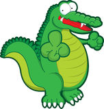 Green croc. A happy crocodile pointing at you Royalty Free Stock Images