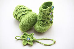 Green crochet baby booties with head band,  on white, crocodile stitch booties Stock Image