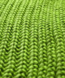 Green crochet background. Closeup of green warm crochet structured textile Stock Photography