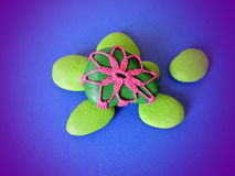 Green  crochet and painted stones Royalty Free Stock Photos