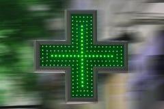 Green cross. THESSALONIKI,GREECE - July,3: Pharmacy neon bulbs green cross Stock Images