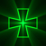 Green cross with bright light flare Stock Image