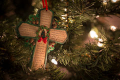 Green cross with Christmas prayer. A close-up shot of a green-edged cross with a Christmas prayer Royalty Free Stock Photo