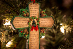 Green cross with prayer. A close-up shot of a green-edged cross featuring a Christmas prayer Royalty Free Stock Photography