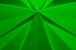 Green cross shaped folded paper as abstract Christmas background. stock photography