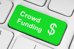 Green crowd funding button. On keyboard Royalty Free Stock Photos