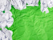 Green Crumpled paper background with crumpled paper ball Stock Photo