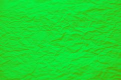 Green crumpled paper texture. Green nature background stock image
