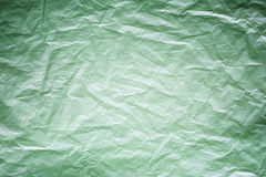 Green crumpled plastic pattern for background texture Royalty Free Stock Images
