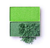 Green crushed eyeshadow for makeup as sample of cosmetic product Royalty Free Stock Photography