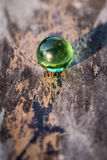 Green crystal ball. Green crystal ball on the old wood Royalty Free Stock Photos
