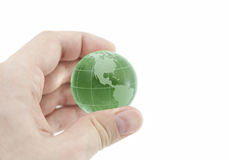 Green crystal globe in hand Stock Photography