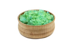 Green crystals of sea salt in a wooden bowl. On a white background Stock Photography