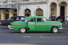 Green Cuban Car in front of cinema Royalty Free Stock Photos