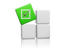 Green cube with check sign on boxes Stock Photography