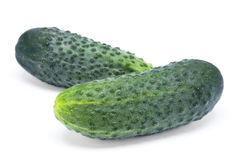 Green cucumber. Vegetable fruits with leafs isolated on white background Royalty Free Stock Photography
