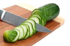 Green cucumber with knife Stock Image